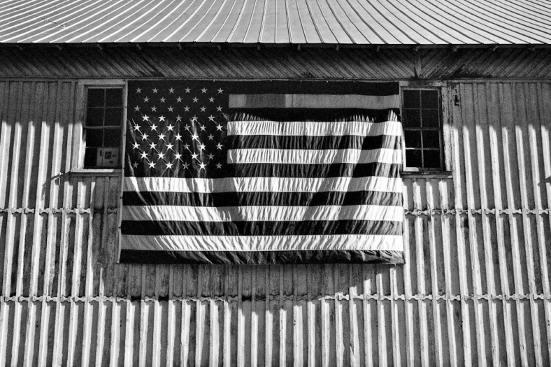 Flag and corrugated metal